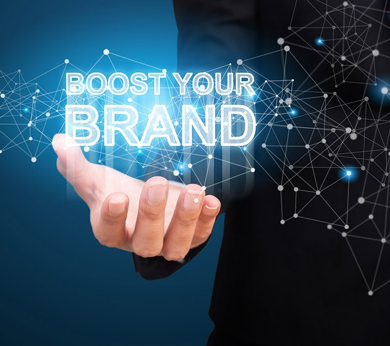 Boost Your Brand in the hand of business. Boost Your Brand concept.